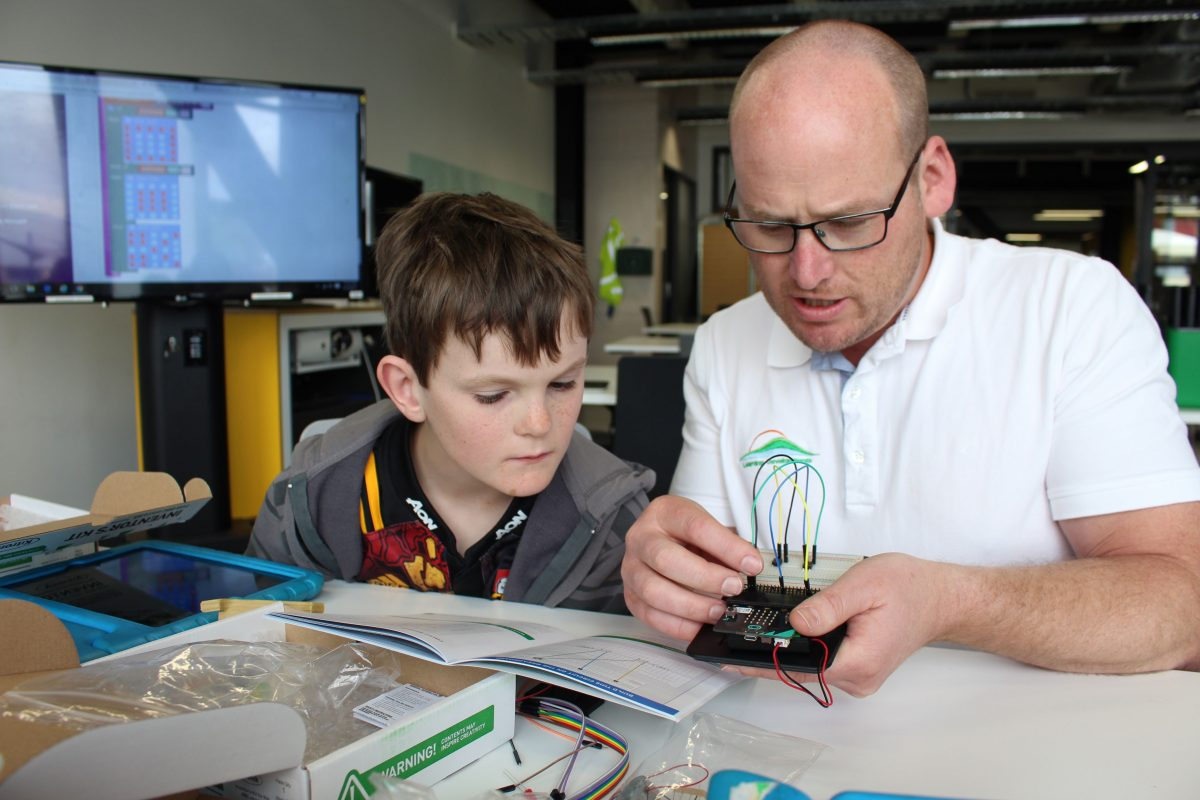 MICROBIT-Learning-Developments-director-Troy-Smith-demonstrates-a-microbit-to-Connor-Geffrey-at-a-David-Street-School-Morrinsville-holiday-programme