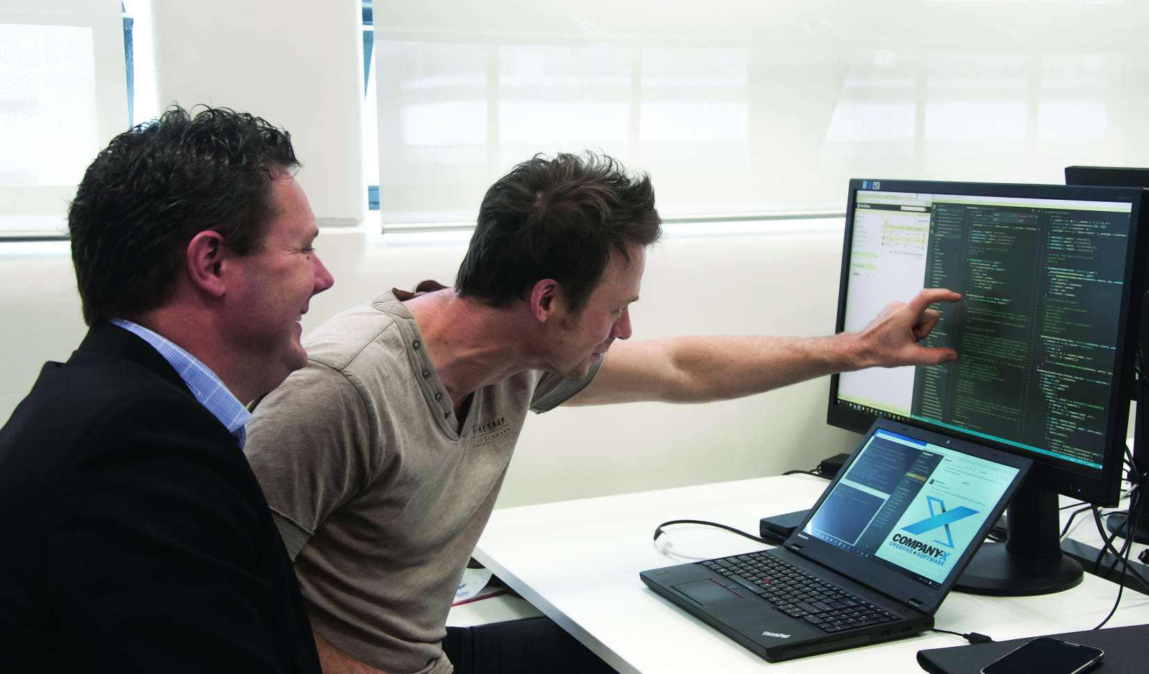 STEAP AHEAD: Company-X software analyst developer Justin Tayor, right, talks Angular 2 with Company-X director David Hallett.